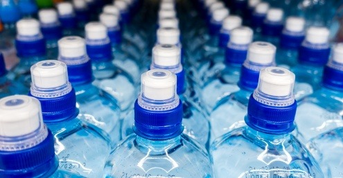 New plastic water bottles in a line