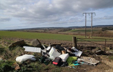 Fly-tipping waste by the side of the road