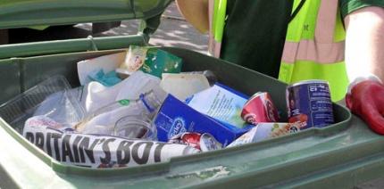 An open co-mingled recycling bin