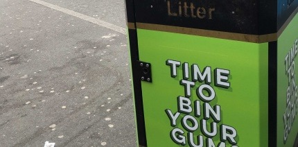 A poster encouraging the public to put gum in the bin