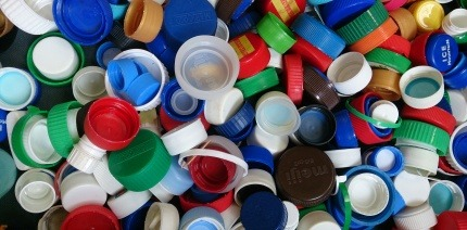 What should you do with plastic bottle caps?