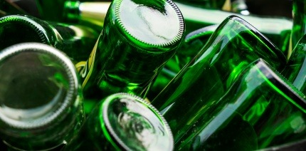 An image of green glass bottles