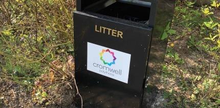 A Cromwell-branded litter bin