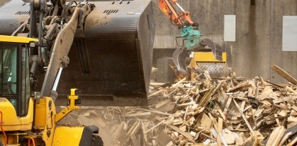 Piles of waste wood at Geminor recycling site