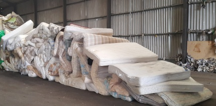 Used mattresses ready for recycling
