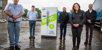 5 people standing in front of a REPIC-labelled fridge unit