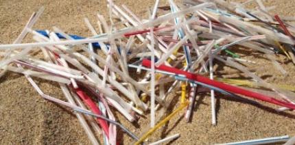Plastic straws on a beach