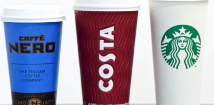 An image of three disposable coffee cups