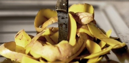 A knife piercing a pile of food waste