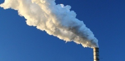 Smoke coming from incinerator chimney