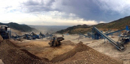 Mining machinery at work on a large-scale excavation site